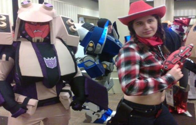 BotCon 2012 - Transformers in costume with a fan