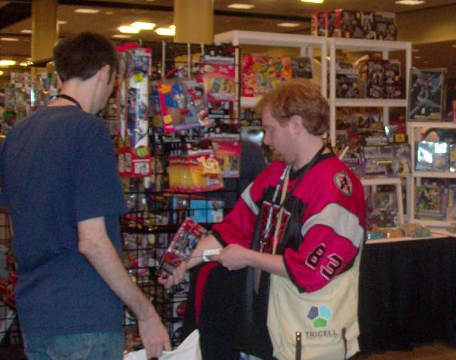 BotCon 2012 - Fan eagerly purchase cool Transformer items!
