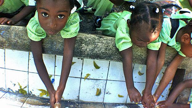 Haitian children washing hands to prevent cholera