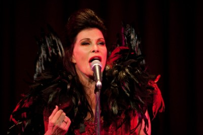 Gorgeous and gifted Jane Badler sings on stage