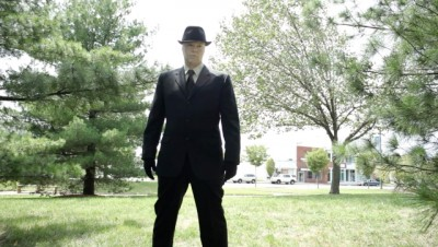 Milgram and the Fast Walkers - Josh Davidson as the  man in in the brimmed hat